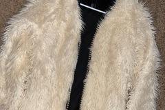 Used: White furry coat